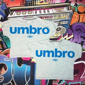 2 like new Umbro T-shirts with the spell out.